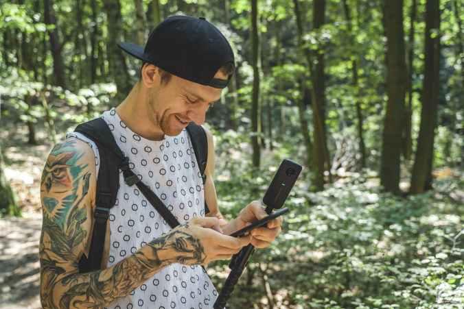 smiling holding smartphone
