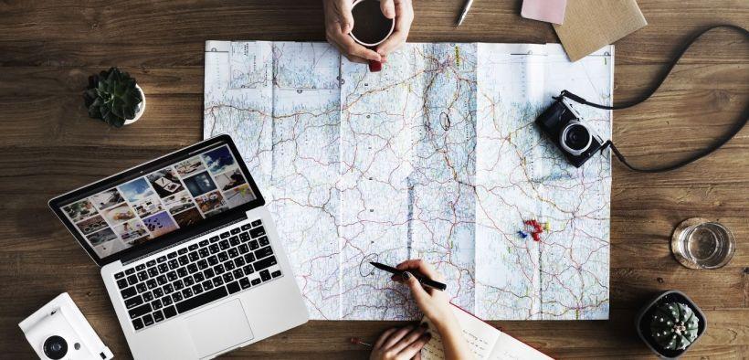 trip planning, macbook, camera, maps, people